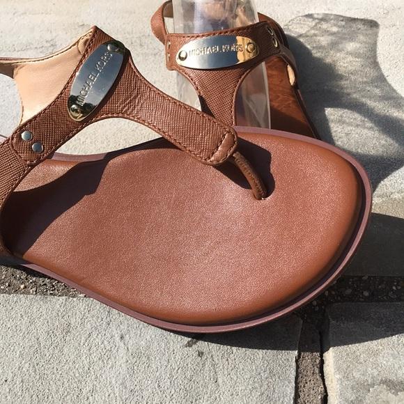 5a0f3bec5 MICHAEL Michael Kors MK Plate Flat Thong Sandals. M 5b6218b712995547d7668c5c